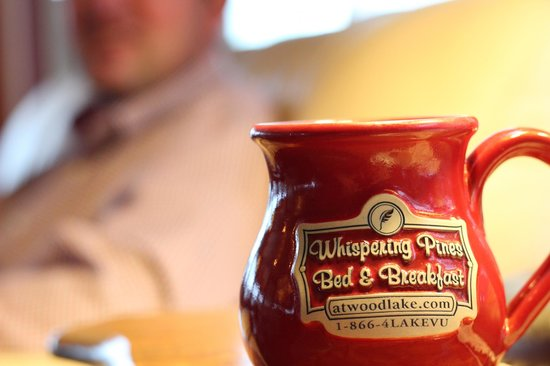 Whispering Pines Bed and Breakfast: Beautiful mugs displayed and for use everywhere and also for sale