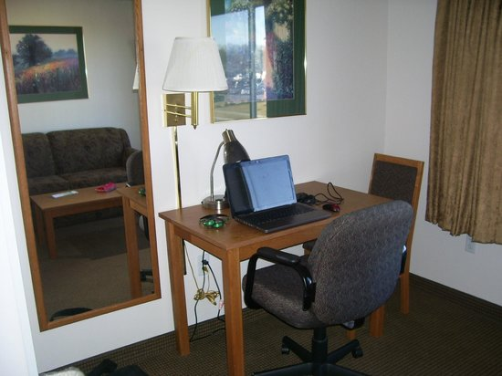 New Victorian Suites Lincoln, NE:                   Desk & Sofa (in mirror)