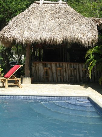 La Veranera - Playa El Coco:                   The pool with the bar behind it.