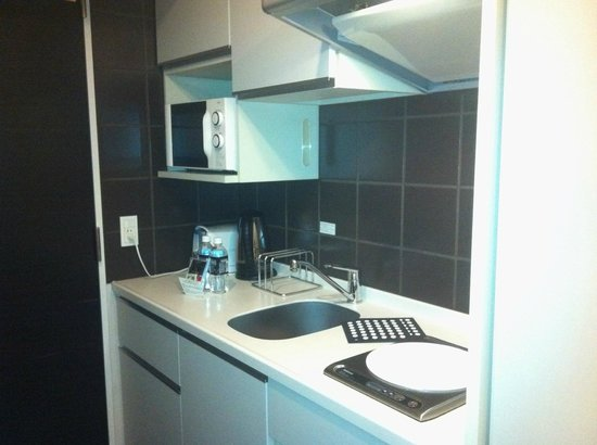 Citadines Shinjuku Tokyo:                   Kitchen equiped with pots, pans, kettle, toaster, fridge, electric cook top an