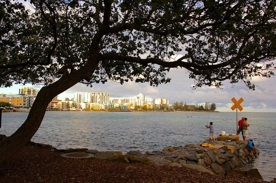 Caloundra, Australia:                   Fishing on the rock wall at the back of Sails Resort on Golden Beach