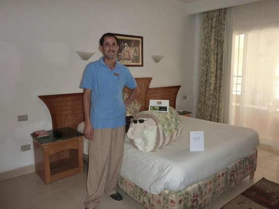 Nabq Bay, Egypt:                   Our room and Osama our friendly room boy with elephant!