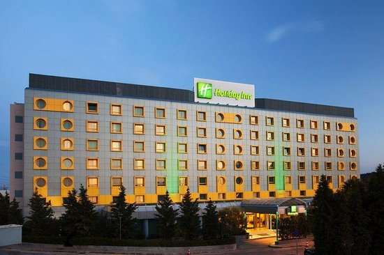 Holiday Inn Athens Attica Avenue Airport West: Hotel Exterior lights on