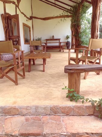 Mara Bush Houses, Asilia Africa:                   Mara House veranda, cozy sofas to sit on to watch the watering hole.
