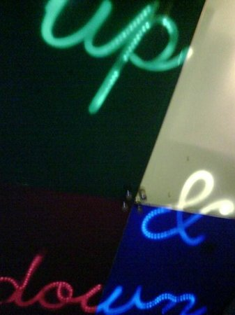 Equity Point London Hotel:                   Colourful Neon Sign On Roof Of Lift