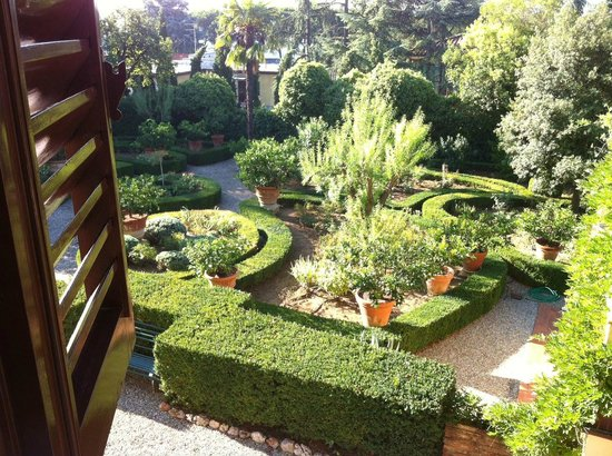 Villa Scacciapensieri:                   View from our room of the gardens of the Villa
