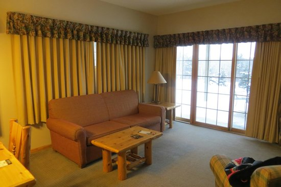 Breezy Point Resort:                                     Living room showing patio doors