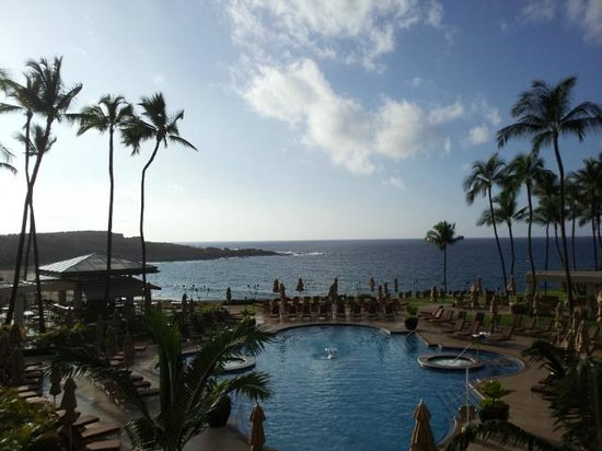 Four Seasons Resort Lana'i at Manele Bay:                   View from lobby overlooking grounds/pool with the blue Pacific sea and sky as