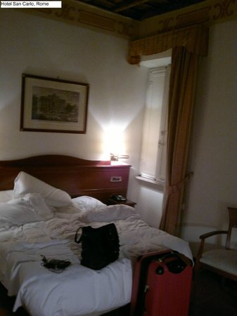 Hotel San Carlo:                   Room - sorry for the unmade bed