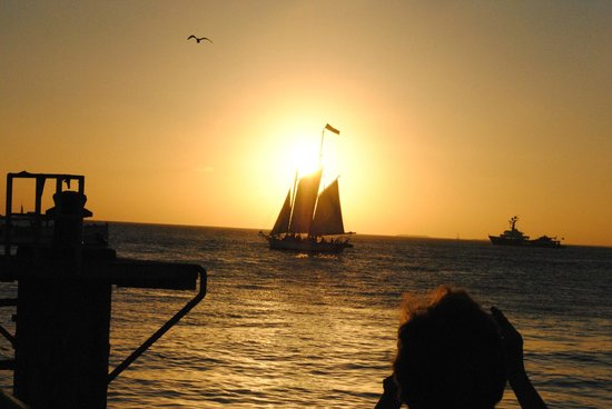 Mallory Square: sunset behind sailboat