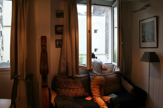 Paris-Oasis:                   Our son watching the tiny birds in the garden below our room