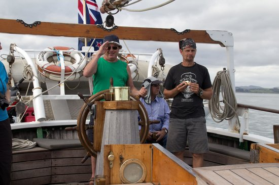 Paihia, New Zealand:                   Me steering (erratically) with captain Steve watching.