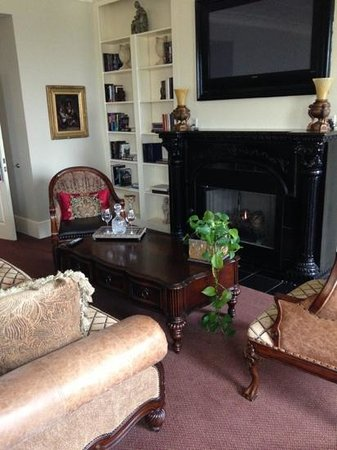 The Grand Hotel:                   sitting area with flatscreen above fireplace
