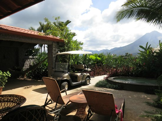 The Springs Resort and Spa at Arenal: Outside area of the Palm Villa. Hammocks, jacuzzi and golf cart