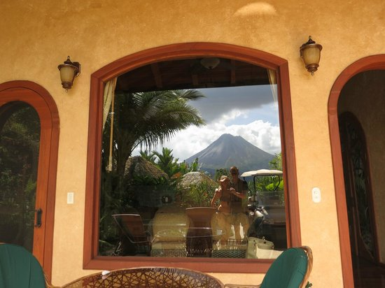 The Springs Resort and Spa at Arenal: reflection in the Palm Villa window