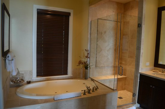 Grand Isle Resort &amp; Spa:                   Whirlpool tub and shower. Dual Vanity.