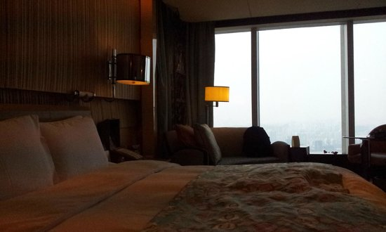 The Ritz-Carlton Shanghai Pudong:                   room view over bed