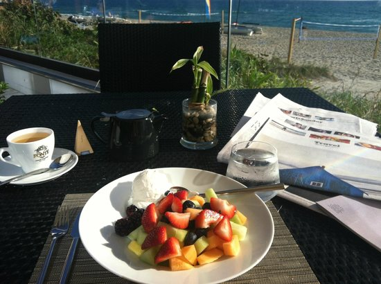 Omphoy Ocean Resort:                   My breakfast on the terrace overlooking the beach