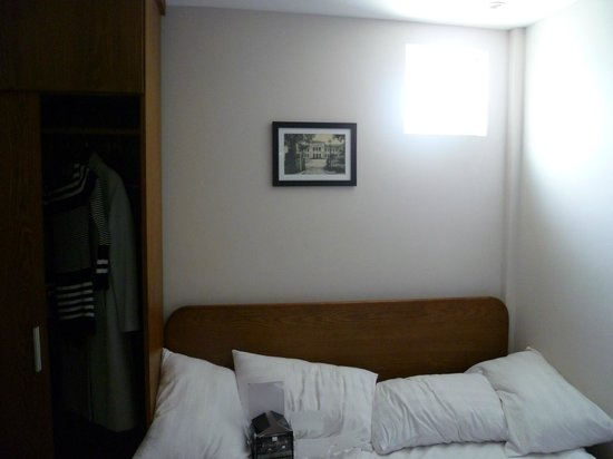 Little Saigon Boutique Hotel:                                     The bed wedged between the wall and the closet/wardrobe