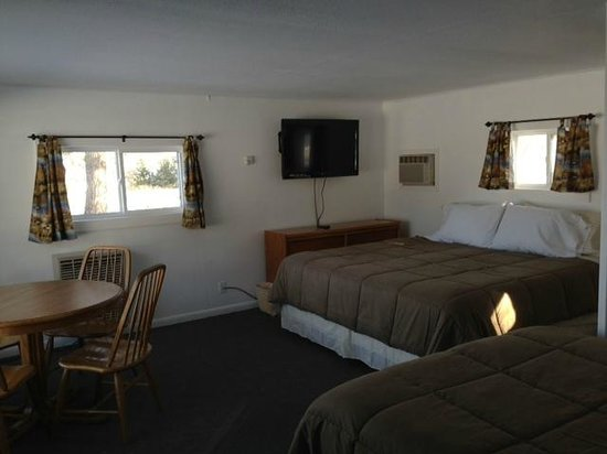 East Jordan Motel: room 8 has a king, double and bunk beds
