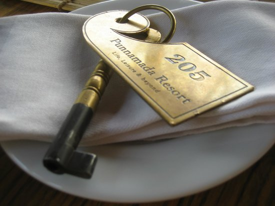 Punnamada Resort:                   The lovely traditional room key opens a hefty old Indian door to your suite.
