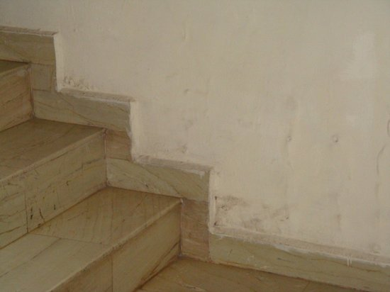 Al Johari:                   peeling paint in staircase