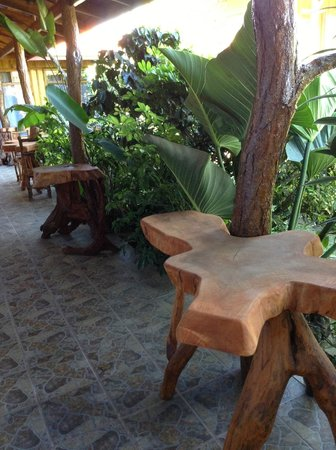 Monteverde Rustic Lodge:                   hand crafted tables and chairs at hotel