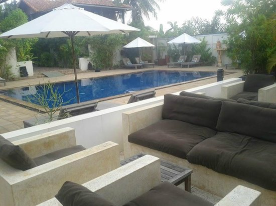 Bambu Battambang Hotel:                                     Stylish concrete chairs and pool area.