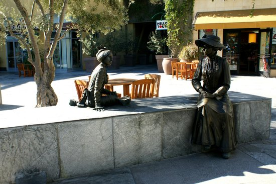 Anaheim Islander Inn and Suites:                   Two bronze carved ladies sitting on a concrete seat