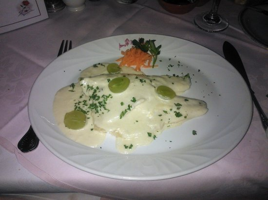 Hadlow, UK:                   Poached Fillet of Sea Bass served in a White Wine Sauce