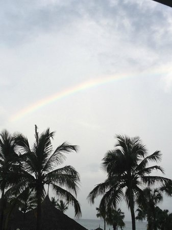 Costa Linda Beach Resort:                   A rainbow from the occasional rain shower