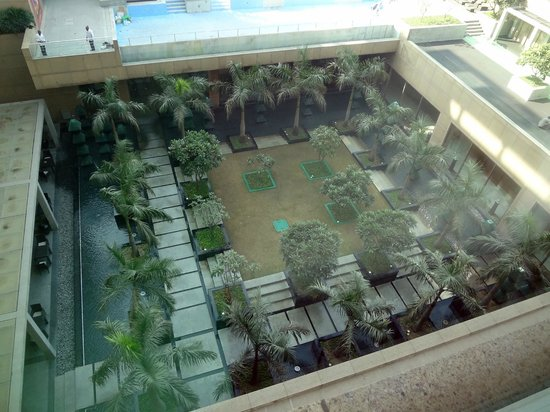 Crowne Plaza Hotel Gurgaon:                   The gardens and pool above from my room