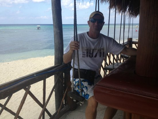 Secrets Aura Cozumel:                   Swings at Sabor bar ocean side