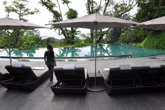 Capella Singapore:                   My wife and the pool...