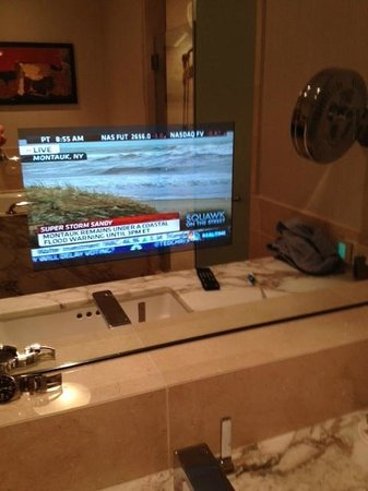 Four Seasons Hotel Seattle:                   Built-in TV of bathroom mirror