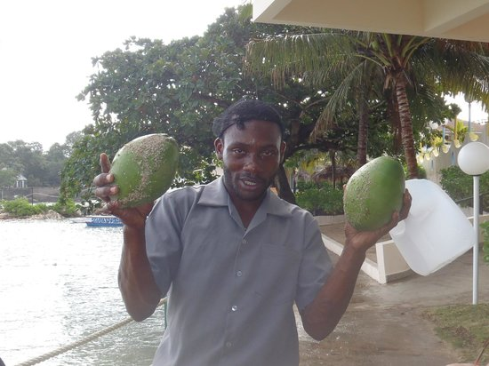 Club Ambiance:                                     Kerry with our coconuts-he was the best!