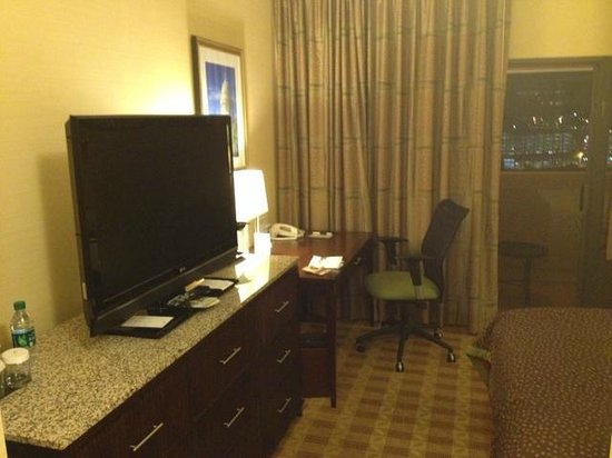 Doubletree Hotel Little Rock: notice the end of the bed and the TV stand. Small but nice!