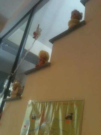 HueNino Hotel:                                     Doll head art on stairs