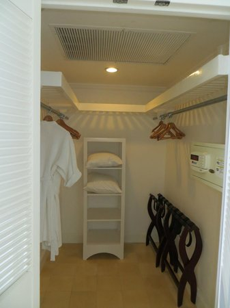 Couples Tower Isle: My walk-in closet.  Look at that room!  Easy to use safe and lots of shelves.