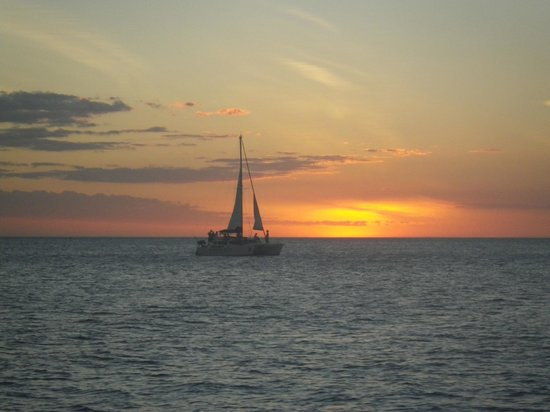 Bahia del Sol Beach Front Hotel & Suites:                   A catamaran at sunset