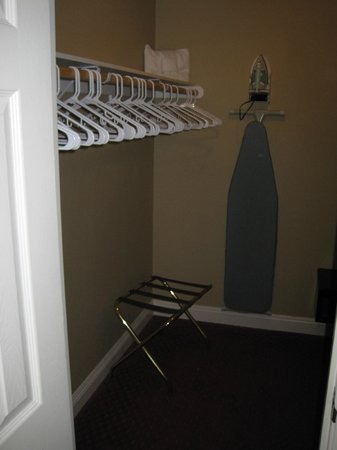 Jockey Club: Walk-in closet with luggage stand and ironing board