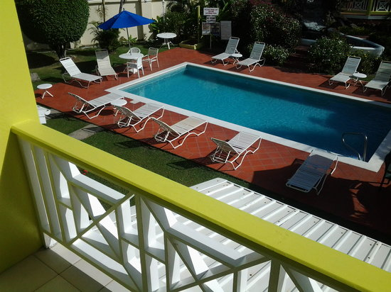 Bay Gardens Hotel:                                     A view of the pool and the hot tub from room 225