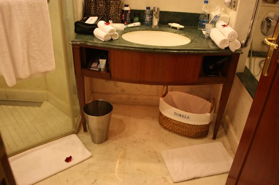 ITC,:                   Fresh flower petals in bathroom
