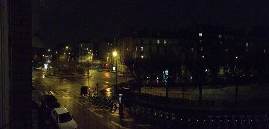 La Villa Paris:                   Nighttime snow falling in Paris