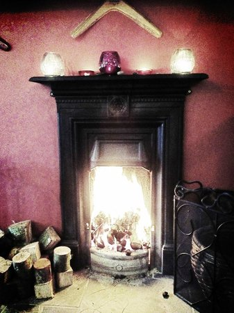 Uluru Bar & Grill:                   The fire in the main dining room is welcoming and warming on the cold Armagh e