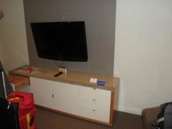 Radisson Hotel And Suites Sydney:                                     tv with the only chest of drawers for clothes