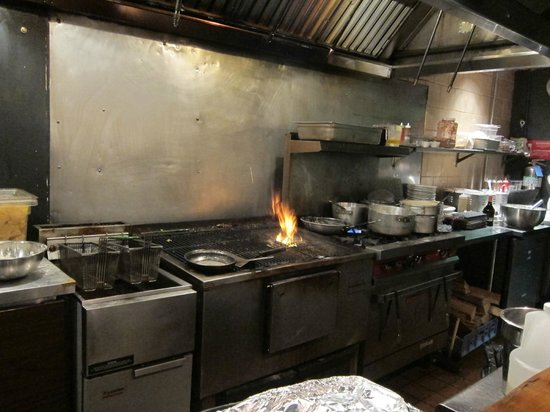 kitchen grill area with wood fire flaming picture of