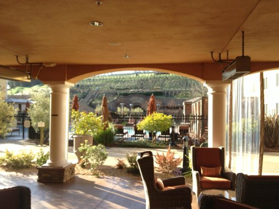 Vino Bello Resort:                   Portico between lobby and pool area viewing wine cave