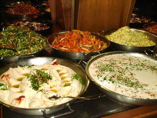 Ginosar, Израиль:                   Salads, hummus and tahini