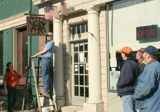 Marietta, PA: Hanging the new sign for Bron's Deli